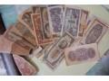 男子炕洞里挖出30万民国纸币 印有孙中山头像